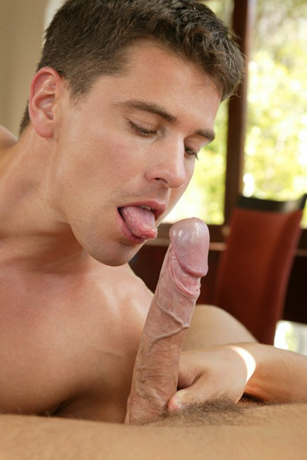 Lukas Ridgeston licks his lips before blowing an uncut cock.